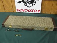 6628 Winchester 101 Diamond Grade 28 gauge 27 inch barrels, Briley chokes 2 sk, ic,mod im full.keys, correct Winchester Diamond Grade case. Kickeze pad lop 14,vent rib ejectors, closes/opens tite. bores brite/shiny. great for birds or clays