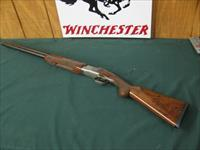6599 Winchester 101 Pigeon XTR Lightweight 20 gauge 27 inch barrels 3 inch chambers,2 Winchester screw in chokes ic/mod, ejectors, vent rib, round knob, quail/snipe engraved in coin silver receiver. winchester butt pad, all original 97-98%