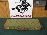 6364 Winchester model 23 Classic 20 gauge 26 inch barrels ic/mod, GOLD RAISED RELIEF PHEASANT BOTTOM OF RECEIVER, Winchester butt pad, vent rib, single select trigger, ejectors, Winchester case, APPEARS UNFIRED, only 900 were mfg, this is #