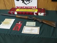 6373 Winchester 101 Field 12 gauge 28 inch barrels 2 3/4 chambers,opens closes tite, bores shiny, vent rib,RED W first 3 years MFG. Winchester butt pad,correct serialized Winchester box.Warranty,instrucions,Marshall Division Military card,F