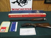 6936 Winchester 101 Field 20 gauge 28 inch barrels, mod/full, pistol grip with cap,Winchester butt plate, ejectors all original, NOT A MARK ON IT. NEW IN BOX papers, pamphlets, warranty card, Winchester box is serialized to the gun. time ca
