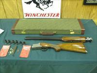6886 Winchester 101 Lightweight 12 gauge 27 inch barrels 8 Winchokes 2sk 2ic 2mod 2 full, 2 wrenches,keys, 2 pouches, correct Winchester case, coin silver engraved pheasants/quail/chukkars,pistol grip, ejectors, Winchester pad, all original