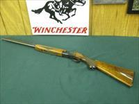 6863 Winchester 101 20 gauge 26 inch barrels ic/mod chokes, 2 3/4 & 3inch chambers, RED W means first 3 years of production, 97% condition,A+Walnut figure, opens/closes tite, bores brite/shiny, shot very little all original, Winchester butt