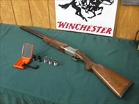 6310 Winchester 101 Pigeon XTR LIGHTWEIGHT 12 gauge 27 inch barrels, 5 chokes and wrench, 2sk ic m f,vent rib round knob long tang Winchester butt pad, pheasants grouse quail engraved coin silver receiver, 99% condition, excellent like new.