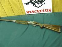 6162 Winchester 101 Pigeon 12 gauge 32 inch barrels im/f, all original, Winchester butt pad,ejectors, vent rib rose and scroll engraved coin silver receiver,early one with diamond tipped engraved receiver,99% conditon, very very hard to fin