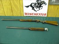 6105 Winchester field 410ga 28bls mod/full, butt plate 97% conditon, all original, opens and closes tite, also the 20 guage barrel and foend that fits, ported 26 inch skeet/skeet, 2 gauges in one gun, amazing, both are high condition.