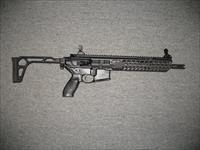 MCX  (SBR Class III) w/key mod forearm rail system, folding stock
