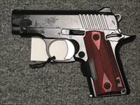 Kimber Micro .380acp (with Red Crimson Trace Laser Grips)