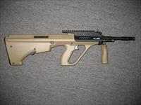 AUG/A3 M1 NATO Stock uses AR-15 style mags Mud (flat Dark Earth) and black finfish