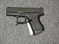 GLOCK  43 w/front night sight and two 6rd mags. (TALO)