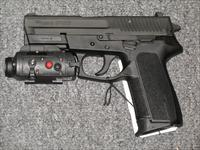 SP2022 (TACPAC) w/Sig Laser (red) Light combo and Night Sights