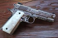 Ruger SR1911 High polish S/S W/ pearlite grips and Fully Engraved