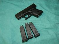 GLOCK MODEL 26 IN 9MM WITH FOUR MAGS