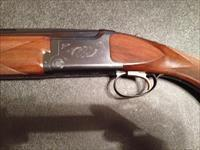 1993 Browning Citori Hunter 12 ga, 28 inch barrels Invector Plus Chokes.  Rare Long Tang model.  Gorgeous condition