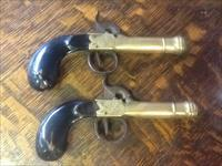Pair of engraved brass cannon barrel percussion pistols