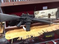 As new  display gun rock river manf.   heavy barrel stainless lar15 20in brl 223