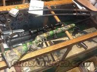 mint as new savage model 64 cammo with  scope