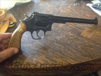 As new smith & WESSON model 14-4 8 3/8 in BRL.  Mint