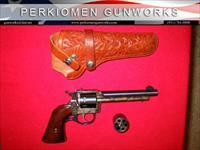 "676 DUAL cylinder, .22lr / .22mag, 5.5"", w/Hand carved Holster."