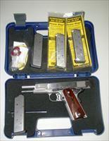 SW 1911E - NIB- with 4 magazines