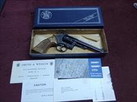 SMITH & WESSON 14-4 .38 SPL. - 6-INCH - APPEARS UNFIRED IN BOX WITH PAPERS
