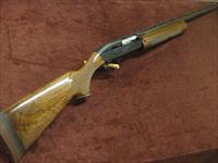 REMINGTON 1100 12GA. - TOURNAMENT GRADE - XX FANCY WOOD - 26-IN. SKEET - VR - EXCELLENT