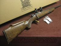 COOPER MODEL 57 M .22LR - CUSTOM SHOP - GOLD ACCENTS - XXX-FANCY WALNUT - APPEARS UNFIRED  IN BOX