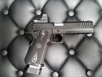 STI 5.0 Tactical 45acp w/Leupold Delta Point Sight