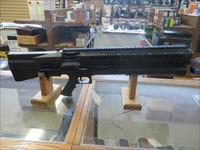 UTAS 15 SHOT 12 GUAGE PUMP ACTION SHOTGUN