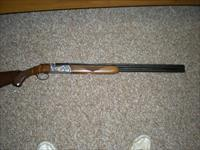 Ruger red label 28 guage    50th year comm.