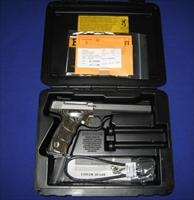 Browning Buck Mark Plus Stainless Black Laminated UDX 22LR Pistol.