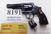 Smith & Wesson .38 Special Model 10-6 Heavy Barrel D820000 range 4 inch 1975 Montreal Police Department Blue with Magna Grips Good partial Refinish Condition