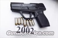 Taurus .40 S&W  PT740 Slim Frame .98 thick 7 Shot Sub Compact 40 Smith & Wesson Caliber Factory Demo 2012 production Excellent in Box with Papers 1 Magazine