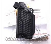 Safariland Duty Holster SSII Glock 17 22 GTL Light Left Hand Shooter 6280837 Safari-Laminate Black Basketweave 2 1/4 inch Slots Tactical Light Unissued with Spacer for Pistols without Lights also fits models 19 & 23