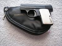 ENGRAVED BABY BROWNING CAL. 25ACP WITH IVORY GRIPS IN POUCH.