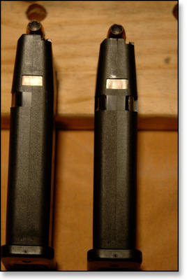 Gen 3 Magazine (left) compared to the Gen 4 Mag (right).   The Gen 4 magazine has cuts on both sides of the magazine body for the magazine release to be reversed for left handed shooters.