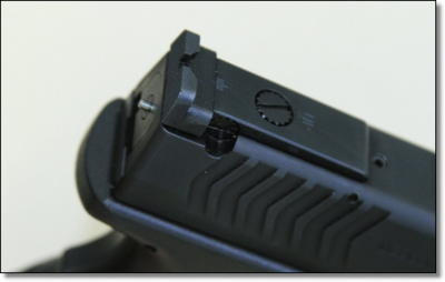 The adjustable rear sight is held by a pin that is held down in a machined slot in the slide. Out of the box you get the lowest profile sight possible, and it is of the highest quality for competition shooters.