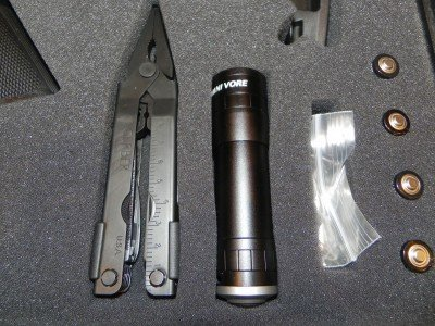 In addition to a multi- tool and flashlight, the ESK has four spare AA batteries.