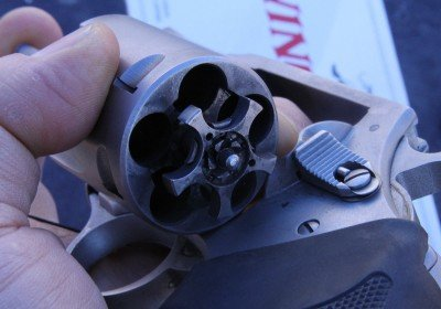 Look inside the cylinders and you will see the little springloaded nubs that hold in the .40S&W rounds. This gun ran all day at Media Day at the Range, SHOT Show 2012, and was filthy as you can see, yet ran and ran with no cleaning.