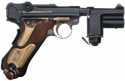 "When you grasped the handle of this Hitler ""Night Pistol"" Luger, your skin conductivity completed a circuit between the two brass panels illuminating a tactical light at the muzzle."
