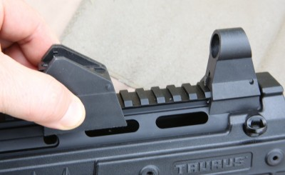 The front and rear sights are movable on the rail.