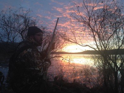 An Arkansas sunrise from the duck blind with the Mossberg Duck Commander 930 in hand. Photo by Denis Dunderdale