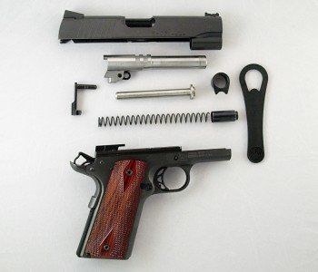The gun is easily field stripped for cleaning either with the supplied bushing wrench or without. The parts in order are the slide, barrel, slide stop, guide rod, barrel bushing, bushing wrench, recoil spring, recoil spring plug, and receiver assembly.