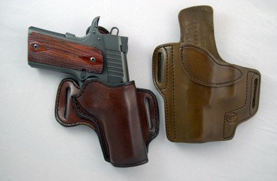 There's a world of holsters available for the 1911. Here are two reasonably priced quality leather holsters. The one on the left with the gun in it is a right handed Extreme cross-draw made by Mernickle Holsters in Fernley, Nevada. The holster on the right is a left handed strong side Predator model made by Wright Leather Works in Green Springs, Ohio.