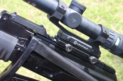 The front pin acts as a hinge for the whole rail, which pivots up off the dust cover, allowing full access to the inside of the receiver.