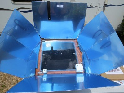 This is how The Sun Oven comes out of the box. The metal wings have a blue coating on them.