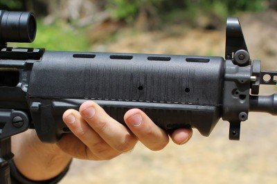 The forend is a handful. With the added sections of rail, it gets even larger. Still, it has ergonomic contours, and you can hold thumb-over-bore if you want.