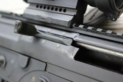 The charging handle on the P556 slides back with the bolt, but it is more easily accessed than an AR's charging handle.