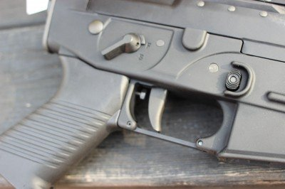 The trigger on the 556 line is wide. If you need more room, the trigger guard can be swapped for a larger one.