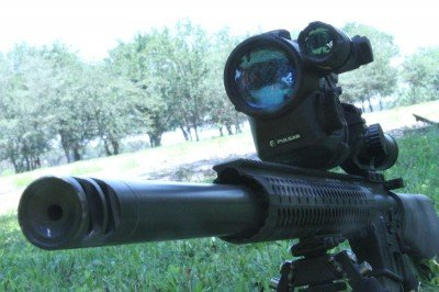 This is the StraightJacket from Teludyne Tech. (it has a night vision attached to the Nikon scope for another article now). The new Sine Pari StraightJacket is better than this Gen3 because they took the gas tube out of the jacket. Expansion of the tube as it heats up was causing the initial shots to walk up on ARs.
